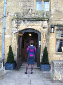 Alice outside the Lygon Arms in an Alice & Co wool jersey dress bak view