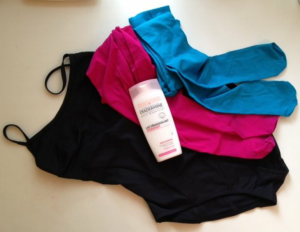 Black Monoprix swimming costume, turquoise tights , pink tights, make up remover