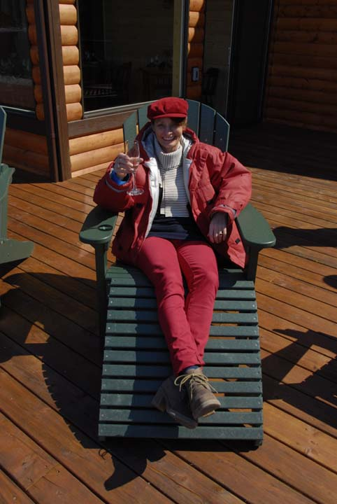 picture of Alice enjoying a glass of champagne on Fox Island, Seward,Alaska