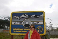 picture of Alice in front of the Whittier tunnel sign