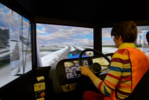 Picture of Alice driving the simulator at Carlile Haulage