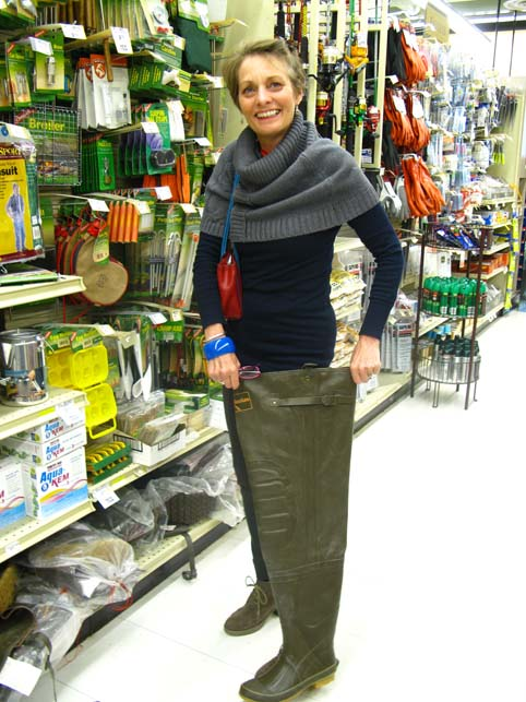 picture of Alice trying a pair of waders in True Value Seward