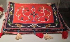 Picture of a handbag made by Native Alaskans in red wool and embroidered