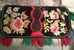 Picture of a wool handbag with crewel work embroidery made by Native Alaskans