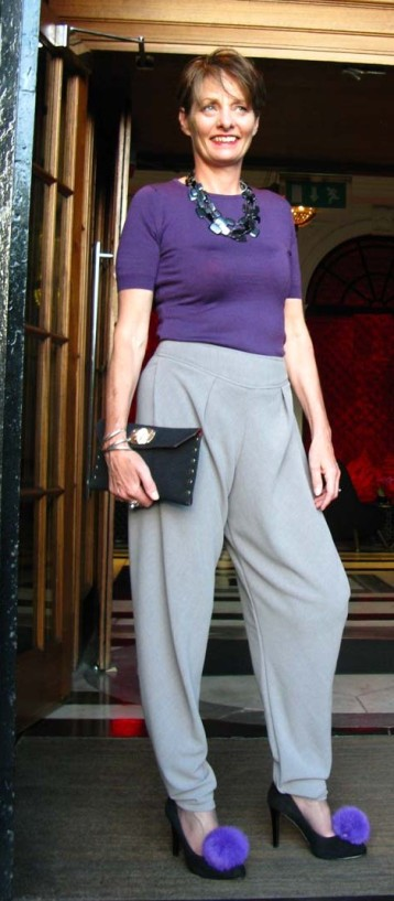 Picture of Alice wearing crepe trousers and a John Smedley sweater in the lobby of the Blytheswood Hotel Glasgow