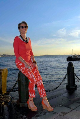 Alice & Co on the Bosphorus in orange print trousers