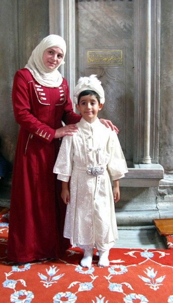 Mother and child in tradituonal costume in the Blue Mosque Istanbul