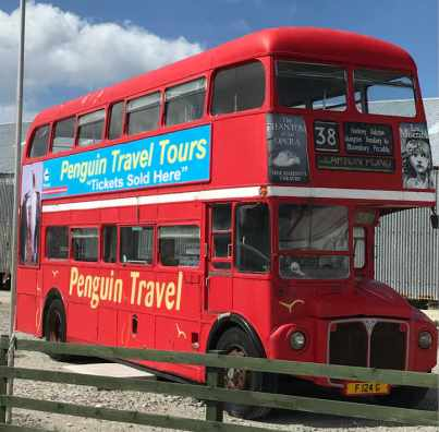 London bus advertising Penguin Tours Stanley Falklands